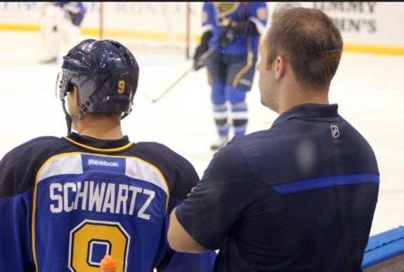 Blues Assistant Equipment Manager Chad O'Neil analyzes a Blues' warm up last season.