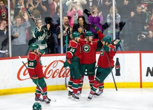 Mikko Koivu celebrates a goal with his teammates. (Brad Rempel-USA TODAY Sports)