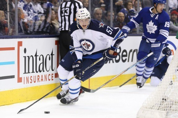 In a short time, Tyler Myers (57) has looked comfortable with his new Jets teammates. (Tom Szczerbowski-USA TODAY Sports)