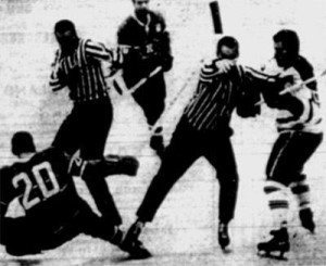 Dave Balon of Montreal falls to the ice after being clubbed by Leafs' Kent Douglas.