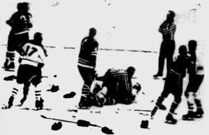 Stan Mikita and Dick Duff in the main event while Elmer Vasko (4) tries to get a closer look.