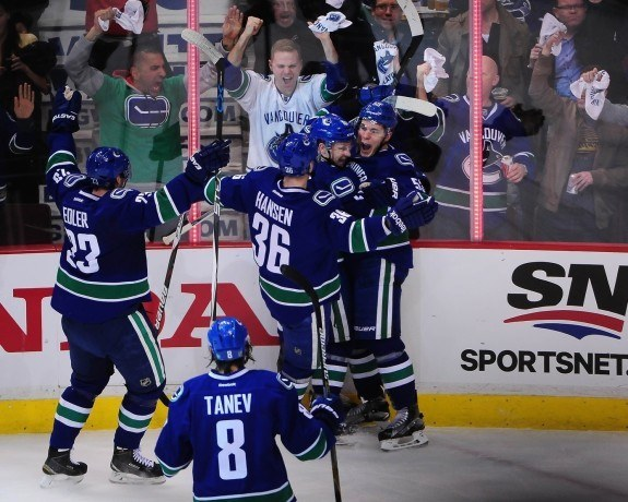 Bo Horvat celebrates with his teammates after scoring the opening goal in game one of their first-round matchup against the Calgary Flames. (Anne-Marie Sorvin-USA TODAY Sports)