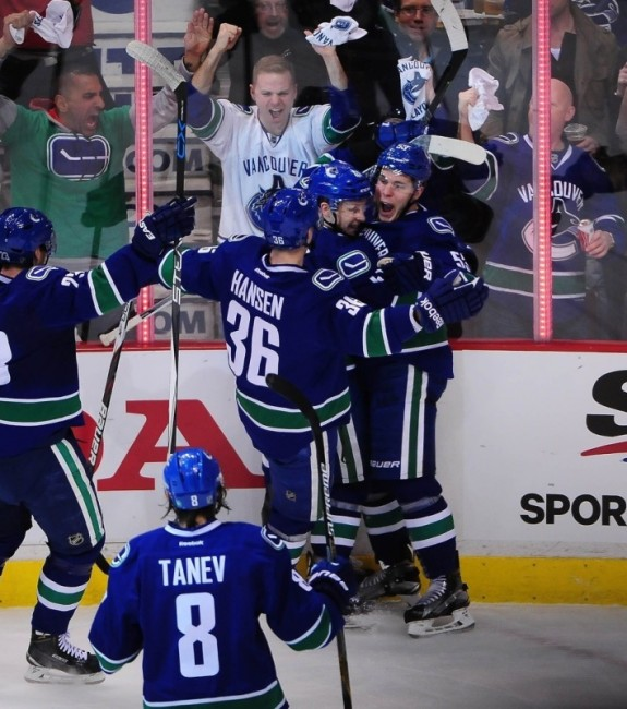 Bo Horvat celebrates his goal against the Calgary Flames in the opening game of their first round series. (Anne-Marie Sorvin-USA TODAY Sports)