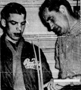 JIm Cardiff, left,  shows off his self-designed stick to Regina manager Del Wilson.