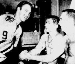 Bobby Hull congratulates Stan Mikita and Ken Wharram after their win at Detroit