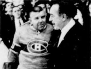 Surprise starter Gump Worsley with coach Toe Blake.
