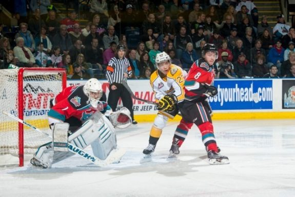 (Marissa Baecker/www.shootthebreeze.ca) Brandon Wheat Kings leading scorer Tim McGauley provides a net-front presence against the Kelowna Rockets as Cole Martin defends and goaltender Jackson Whistle watches for an incoming shot during WHL regular-season action on Oct. 25.