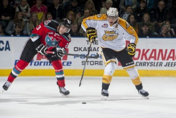 (Marissa Baecker/www.shootthebreeze.ca) Brandon Wheat Kings defenceman Eric Roy, right, lugs the puck up the ice as Kelowna Rockets forward Justin Kirkland gives chase during WHL regular-season action on Oct. 25 in Kelowna.