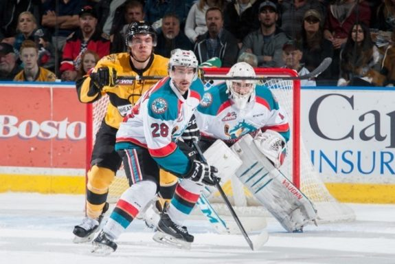 (Marissa Baecker/Shoot The Breeze) Kelowna Rockets goaltender Jackson Whistle watches for an incoming shot while Joe Gatenby (28) defends against the Brandon Wheat Kings in the WHL final.