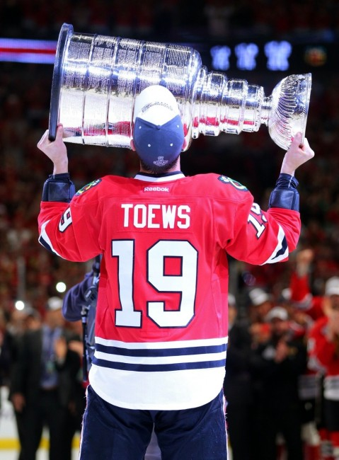 Jonathan Toews hoists the Stanley Cup for the third time six seasons. (Dennis Wierzbicki-USA TODAY Sports)
