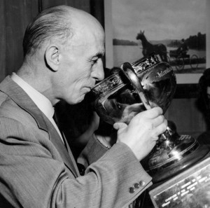 Eddie Shore sips from the Calder Cup.