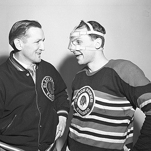 Hawks coach Sid Abel with Gus Mortson, who played through many injuries.