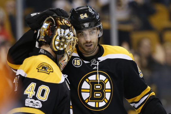 Tuukka Rask and Adam McQuaid