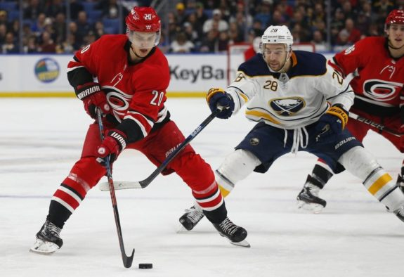 Buffalo Sabres forward Zemgus Girgensons and Carolina Hurricanes forward Sebastian Aho