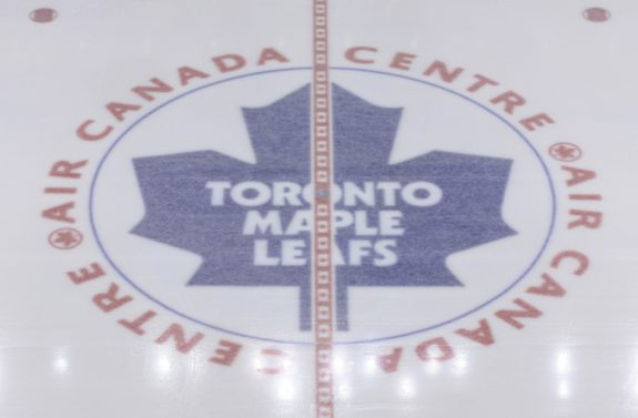 The Toronto Maple Leafs logo at center ice