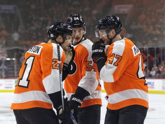 Andrew MacDonald #47, Oskar Lindblom #54 and Scott Laughton #21