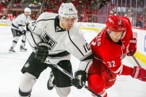 Los Angeles Kings defenseman Christian Ehrhoff (10) and Carolina Hurricanes right wing Kris Versteeg (32) during the NHL game between the Los Angeles Kings and the Carolina Hurricanes at the PNC Arena.