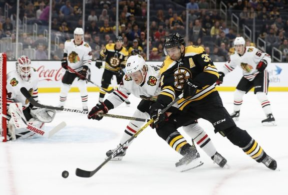 Boston Bruins Patrice Bergeron Chicago Blackhawks Adam Boqvist