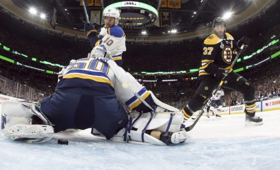St. Louis Blues Jordan Binnington Boston Bruins' Patrice Bergeron
