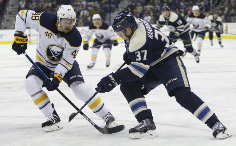 Buffalo Sabres' Matt Hunwick and Columbus Blue Jackets' Markus Hannikainen