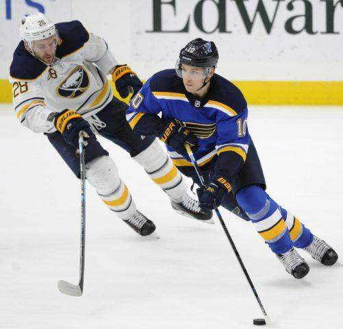 Buffalo Sabres' Zemgus Girgensons chases St. Louis Blues' Brayden Schenn
