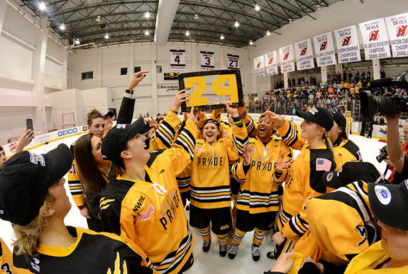 Alyssa Gagliardi holds up Denna Laing's no. 24 as the Boston Pride celebrate their Isobel Cup win. (Photo Credit: Troy Parla)