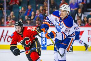 Edmonton Oilers defenseman Brandon Davidson and Calgary Flames left wing Dillon Dube (Sergei Belski-USA TODAY Sports)