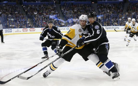 Brian Dumoulin of the Pittsburgh Penguins against Anton Stralman of the Lightning