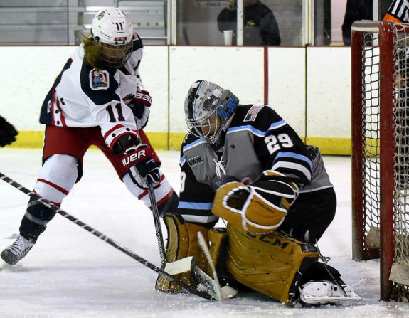 Brianne McLaughlin of the Buffalo Beauts makes a save on Morgan Fritz-Ward of the New York Riveters. (Photo Credit: Troy Parla)