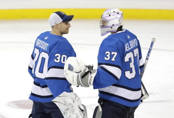 Winnipeg Jets goaltender Laurent Brossoit and Connor Hellebuyck
