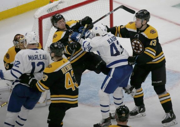 Boston Bruins and Toronto Maple Leafs shove each other around