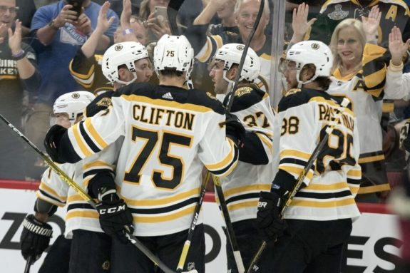 Boston Bruins Connor Clifton Matt Grzelcyk, Brad Marchand David Pastrnak