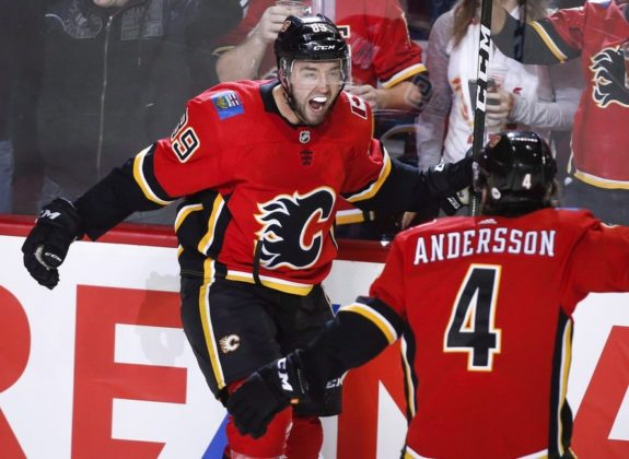 Calgary Flames' Alan Quine and Rasmus Andersson