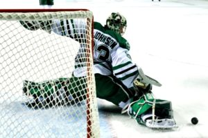 UND goalie Cam Johnson makes a save. (Photo Credit: Russell Hons UNDSports.com)