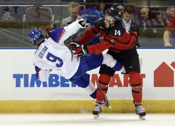 Anaheim Ducks prospect Maxime Comtois checks Team Slovakia's Andrej Golian