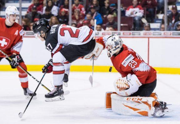 Canada's Barrett Hayton Switzerland goalie Akira Schmid