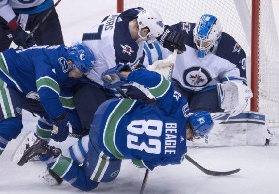 Winnipeg Jets Tyler Myers Laurent Brossoit Vancouver Canucks Jay Beagle