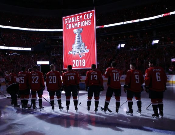 The Capitals watch as the 2018 Stanley Cup championship banner is raised to the rafters.