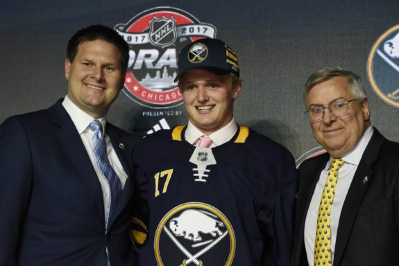 Casey Mittlestadt with Jason Botterill and Terry Pegula.