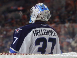 Connor Hellebuyck will look to step his game up in the New Year (Amy Irvin/ The Hockey Writers)