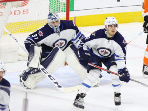 Connor Hellebuyck and Brandon Tanev - Winnipeg Jets vs Philadelphia Flyers - November 17, 2016 (Amy Irvin / The Hockey Writers)