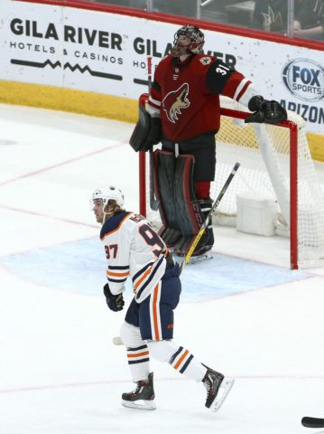 Edmonton Oilers center Connor McDavid and Arizona Coyotes goaltender Adin Hill