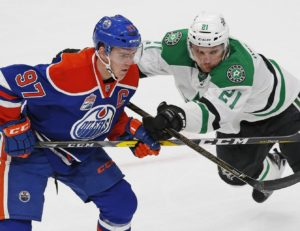 Connor McDavid (97) and Antoine Roussel (21) (Perry Nelson-USA TODAY Sports)