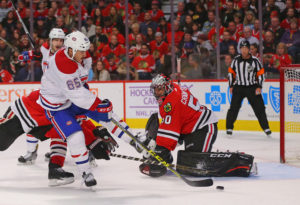 Montreal Canadiens forward Andrew Shaw and Chicago Blackhawks goalie Corey Crawford