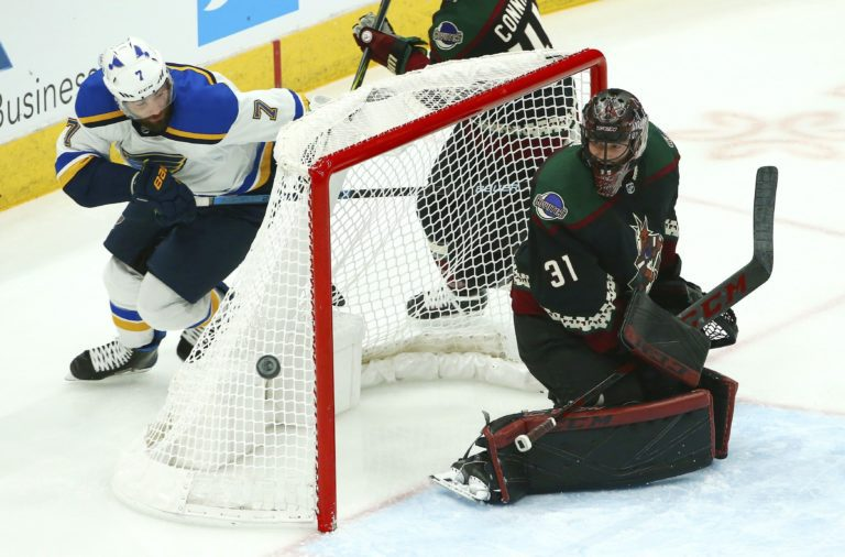 St. Louis Blues left wing Pat Maroon Arizona Coyotes goaltender Adin Hill