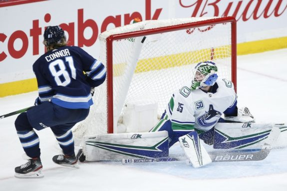 Winnipeg Jets' Kyle Connor Vancouver Canucks Thatcher Demko