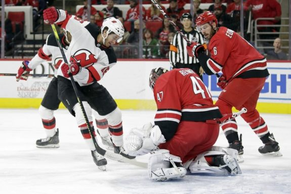 New Jersey Devils Kevin Rooney Carolina Hurricanes James Reimer Joel Edmundson
