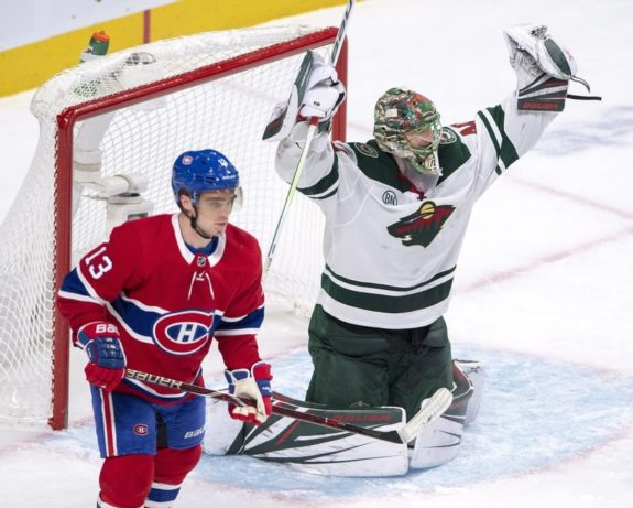 Minnesota Wild goalie Devan Dubnyk and Montreal Canadiens forward Max Domi