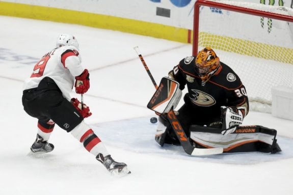Anaheim Ducks Ryan Miller blocks a shot by New Jersey Devils Taylor Hall