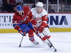 Montreal Canadiens forward Michael McCarron and Detroit Red Wings forward Dylan Larkin
